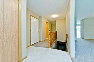 Photo 18: 132 DEER RIDGE Close SE in Calgary: Deer Ridge Semi Detached for sale : MLS®# C4303155
