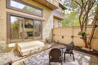 Photo 39: 64 Glamis Gardens SW in Calgary: Glamorgan Row/Townhouse for sale : MLS®# A1112302