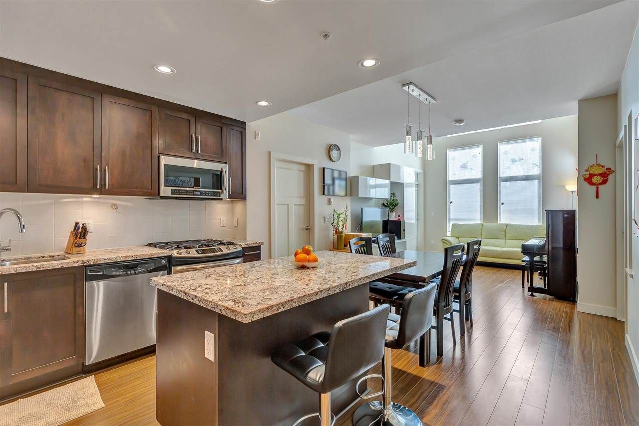 """Main Photo: 409 15428 31 Avenue in Surrey: Grandview Surrey Condo for sale in """"Headwaters phase 1"""" (South Surrey White Rock)  : MLS®# R2583297"""