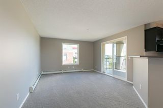 Photo 8: 8329 304 MACKENZIE Way SW: Airdrie Apartment for sale : MLS®# A1128736