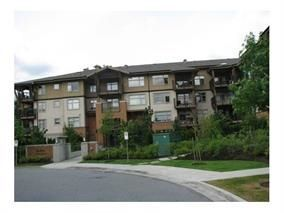 "Photo 1: 409 300 KLAHANIE Drive in Port Moody: Port Moody Centre Condo for sale in ""TIDES"" : MLS®# R2213447"