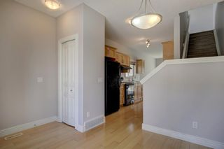 Photo 3: 76 Bridleridge Manor SW in Calgary: Bridlewood Row/Townhouse for sale : MLS®# A1106883