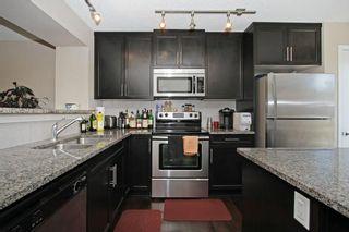 Photo 4: 105 AUBURN BAY Square SE in Calgary: Auburn Bay House for sale : MLS®# C4141384