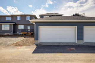 Photo 32: 112 Creekside Drive SW in Calgary: C-168 Semi Detached for sale : MLS®# A1060918