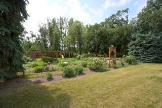 Photo 79: 39066 Road 64 N in Portage la Prairie RM: House for sale : MLS®# 202116718