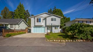 Photo 1: 2483 KITCHENER Avenue in Port Coquitlam: Woodland Acres PQ House for sale : MLS®# R2619953