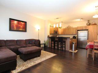 Photo 3: 517 10 AUBURN BAY Avenue SE in Calgary: Auburn Bay Townhouse for sale : MLS®# C3603479