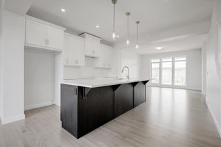 Photo 11: 112 Creekside Drive SW in Calgary: C-168 Semi Detached for sale : MLS®# A1060918
