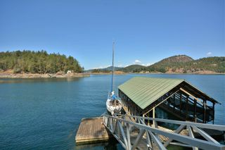 Photo 1: 4067 FRANCIS PENINSULA Road in Madeira Park: Pender Harbour Egmont House for sale (Sunshine Coast)  : MLS®# R2604603