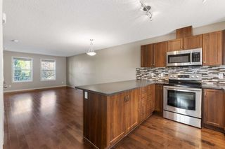 Photo 41: 122 Sunset Road: Cochrane Row/Townhouse for sale : MLS®# A1127717