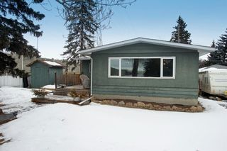 Main Photo: 179 Westwood Drive SW in Calgary: Westgate Detached for sale : MLS®# A1074385
