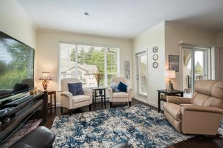 """Photo 6: 411 20281 53A Avenue in Langley: Langley City Condo for sale in """"Gibbons Layne"""" : MLS®# R2621680"""