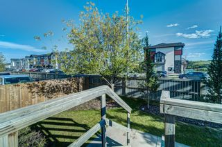 Photo 43: 4 136 Bow Ridge Drive: Cochrane Row/Townhouse for sale : MLS®# A1116097