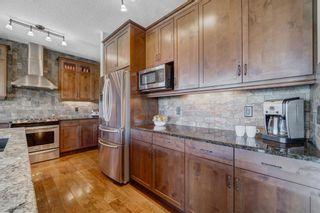 Photo 10: 102 Ridge View Place: Cochrane Detached for sale : MLS®# A1147672