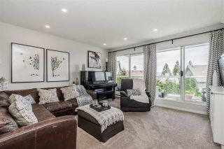 """Photo 4: 309 2733 ATLIN Place in Coquitlam: Coquitlam East Condo for sale in """"Atlin Court"""" : MLS®# R2355096"""