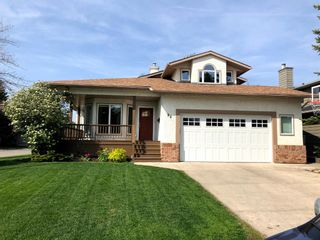 Photo 1: 94 Sunset Way SE in Calgary: Sundance Detached for sale : MLS®# A1136113