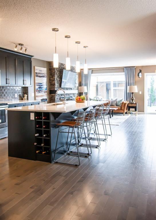 Photo 2: Photos: 281 AUBURN MEADOWS Place SE in Calgary: Auburn Bay Duplex for sale : MLS®# A1014528