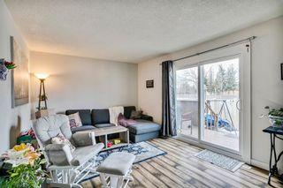 Photo 7: 14 14736 Deerfield Drive in Calgary: Deer Run Row/Townhouse for sale : MLS®# A1092282