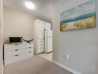 Photo 11: 516 3130 66 Avenue SW in Calgary: Lakeview Row/Townhouse for sale : MLS®# A1024120