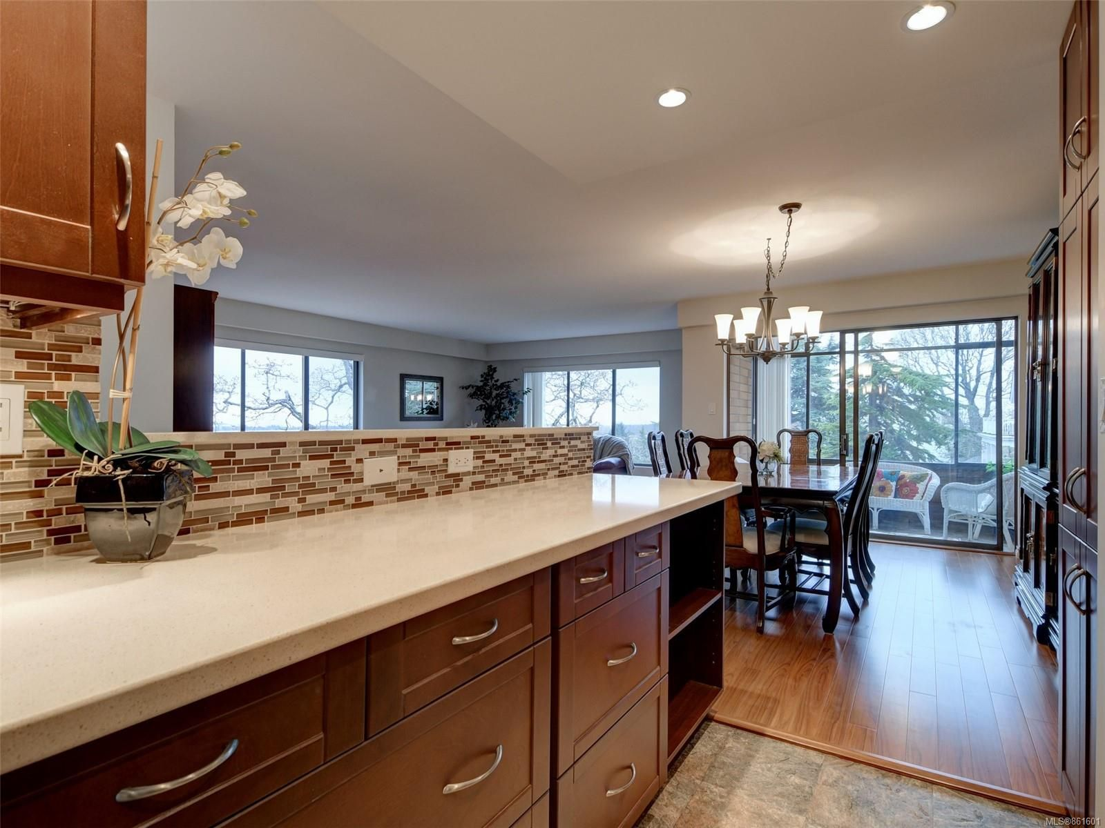 Renovated Kitchen with wall removed to open space and enjoy wrap-around windows
