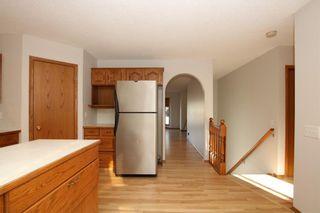 Photo 10: 22 WEST COPITHORNE Place: Cochrane House for sale : MLS®# C4121744