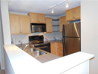 """Photo 2: 112 1111 LYNN VALLEY Road in North Vancouver: Lynn Valley Condo for sale in """"THE DAKOTA"""" : MLS®# V980759"""
