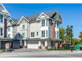 Photo 1: 21 20723 FRASER Highway in Langley: Langley City Townhouse for sale : MLS®# R2398005