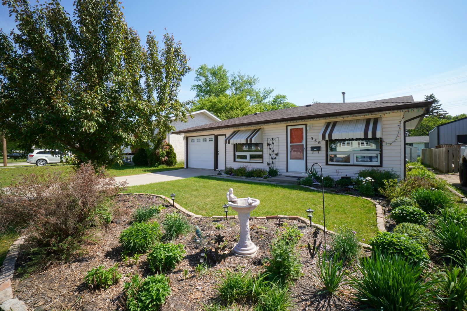 Main Photo: 356 10th Street NW in Portage la Prairie: House for sale : MLS®# 202114076