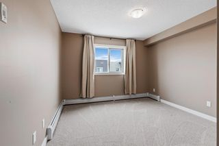 Photo 10: 7411 403 Mackenzie Way SW: Airdrie Apartment for sale : MLS®# A1152134