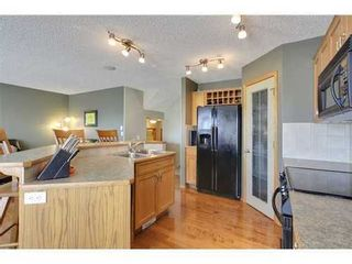 Photo 8: 290 COUGARSTONE Circle SW in Calgary: 2 Storey for sale : MLS®# C3586992