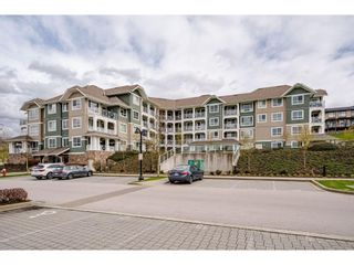 "Photo 2: 210 16398 64 Avenue in Surrey: Cloverdale BC Condo for sale in ""THE RIDGE AT BOSE FARM"" (Cloverdale)  : MLS®# R2560032"