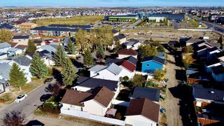 Photo 2: 305 Martinwood Place NE in Calgary: Martindale Detached for sale : MLS®# A1038589