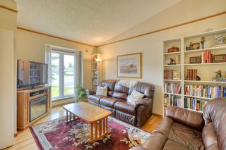 Photo 8: 20A Woodmeadow Close SW in Calgary: Woodlands Row/Townhouse for sale : MLS®# A1127050