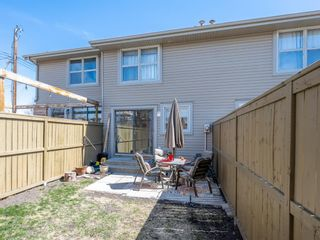 Photo 14: 55 123 Queensland Drive SE in Calgary: Queensland Row/Townhouse for sale : MLS®# A1101736
