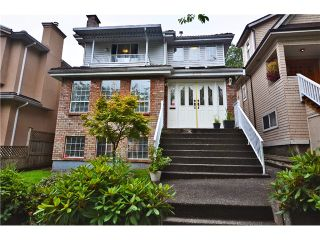 """Photo 1: 878 E 23RD AV in Vancouver: Fraser VE House for sale in """"CEDAR COTTAGE"""" (Vancouver East)  : MLS®# V1022949"""