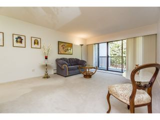 "Photo 9: 210 150 E 5TH Street in North Vancouver: Lower Lonsdale Condo for sale in ""NORMANDY HOUSE"" : MLS®# R2051568"