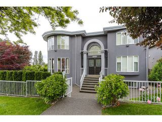 Photo 1: 7687 MARY AVE - LISTED BY SUTTON CENTRE REALTY in Burnaby: Edmonds BE House for sale (Burnaby East)  : MLS®# V1126167
