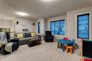 Photo 11: 144 Cougar Ridge Manor SW in Calgary: Cougar Ridge Detached for sale : MLS®# A1098625