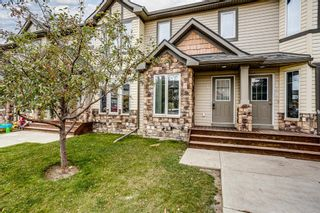Photo 1: 107 2445 Kingsland Road SE: Airdrie Row/Townhouse for sale : MLS®# A1151788