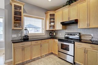 Photo 11: 170 Everglade Way SW in Calgary: Evergreen Detached for sale : MLS®# A1086306