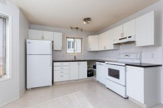 Photo 3: 887 Erin Woods Drive SE in Calgary: Erin Woods Detached for sale : MLS®# A1099055