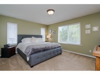 """Photo 11: 18276 69 Avenue in Surrey: Cloverdale BC House for sale in """"Cloverwoods"""" (Cloverdale)  : MLS®# R2369738"""