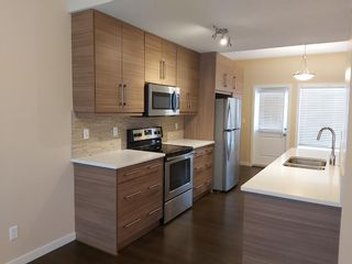 Photo 4: 398 Nolancrest Heights NW in Calgary: Nolan Hill Row/Townhouse for sale : MLS®# A1042890