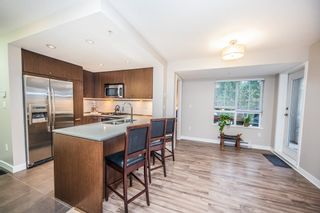 "Photo 5: 308 2940 KING GEORGE Boulevard in Surrey: King George Corridor Condo for sale in ""High Street"" (South Surrey White Rock)  : MLS®# R2229056"