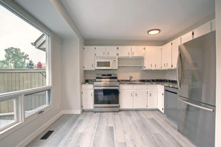 Photo 6: 77 123 Queensland Drive SE in Calgary: Queensland Row/Townhouse for sale : MLS®# A1145434