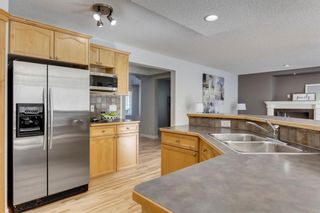 Photo 11: 12469 Crestmont Boulevard SW in Calgary: Crestmont Detached for sale : MLS®# A1109219