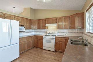 Photo 12: 426 Riverview Green: Cochrane Detached for sale : MLS®# A1132015