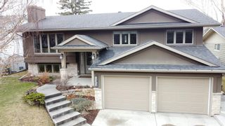 Photo 1: 6742 Leaside Drive SW in Calgary: Lakeview Detached for sale : MLS®# A1063976