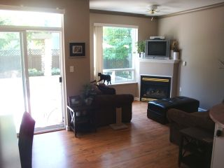Photo 2: 103 5475 201 Street in HERITAGE PARK: Home for sale