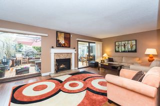 """Photo 1: 1 3150 E 58TH Avenue in Vancouver: Champlain Heights Townhouse for sale in """"HIGHGATE"""" (Vancouver East)  : MLS®# R2142196"""